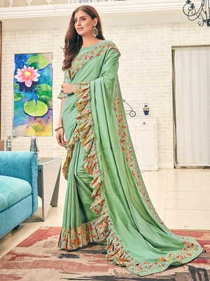 Green plain silk saree with blouse