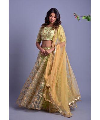 Pista green net lehenga set with golden blouse
