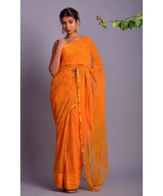 yellow printed bandhej chiffon saree with blouse