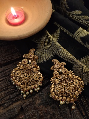 Gold Tone Temple Earring