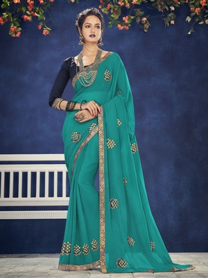teal embroidered chiffon saree with blouse