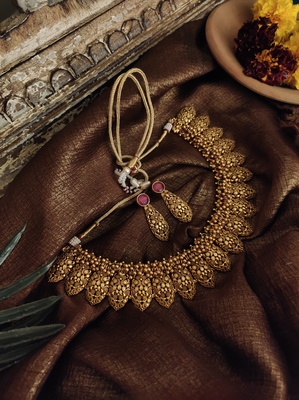 Gold Tone Temple Necklace With Earrings