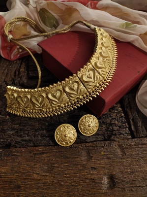 Gold Tone Temple Necklace With Studs