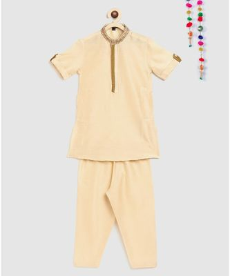 beige kurta with embroidery panel on collar and double colored panel on front, and pajama