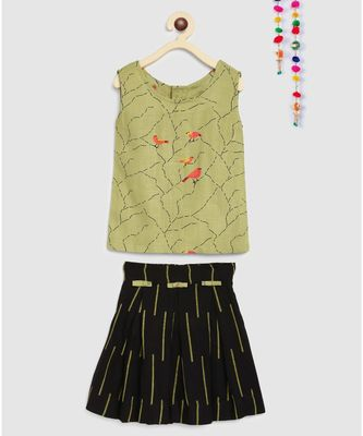 green short crop top with box pleated skirt