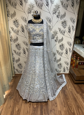 Grey embroidered net semi stitched lehenga