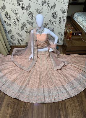 Peach embroidered silk semi stitched lehenga