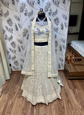 White Embroidered Net Semi Stitched Lehenga