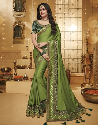 Green embroidered silk blend saree with blouse