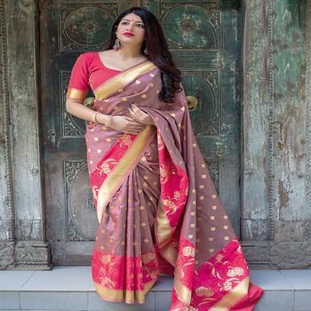 Rani pink woven silk blend saree with blouse