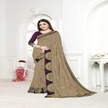 Dark maroon embroidered silk saree with blouse