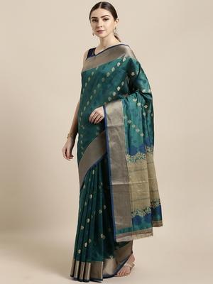 Sea green woven raw silk saree with blouse