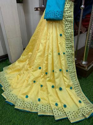yellow art silk pompom saree with blouse