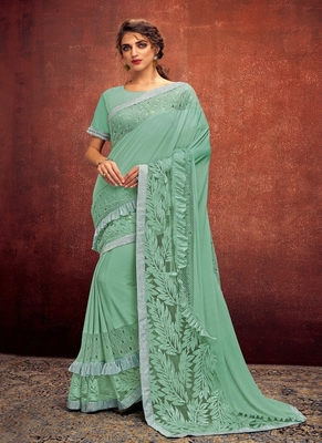 sea green embroidered lycra saree with blouse