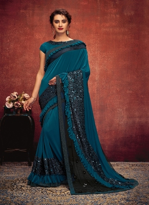 Teal embroidered lycra saree with blouse