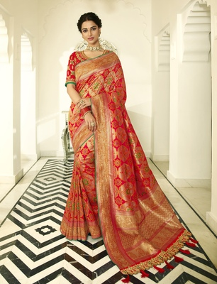 Orange embroidered banarasi silk saree with blouse