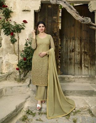 Mustard embroidered Net semi stitched salwar with dupatta