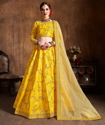 Yellow zari, dori , thread and sequins embroidered art silk semi stitched lehenga choli with dupatta