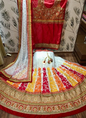 Off-white embroidered net semi stitched lehenga