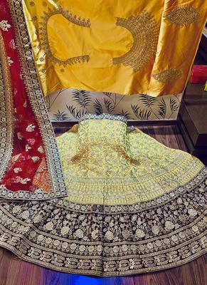 Yellow embroidered satin semi stitched lehenga