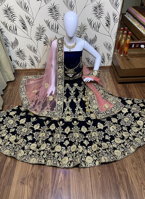 Blue embroidered velvet semi stitched lehenga