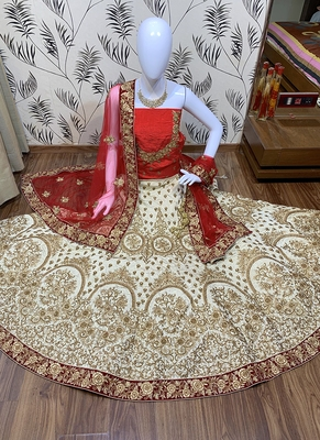 Off-white embroidered satin semi stitched lehenga