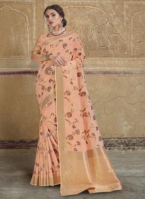 light peach woven silk blend saree with blouse