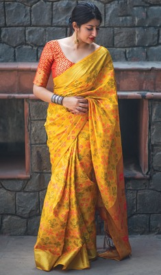 Yellow woven patola saree with blouse