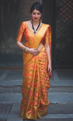 Mustard woven patola saree with blouse