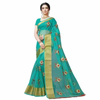Turquoise embroidered organza saree with blouse
