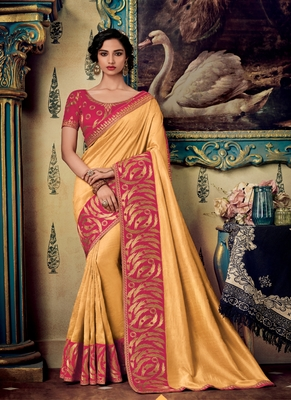 Cream embroidered fancy fabric saree with blouse