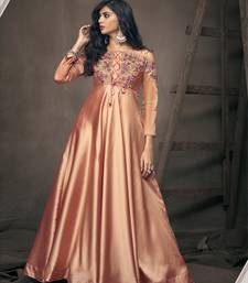 Orange embroidered silkparty wear gown