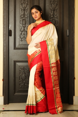 Off white woven silk blend saree with blouse