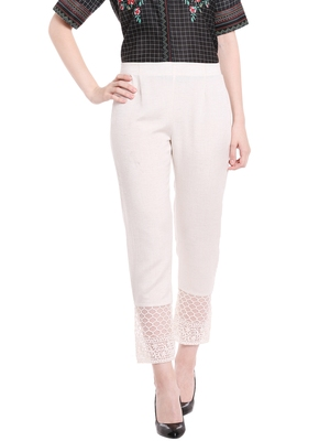 Off White Solid Pants With Lace At Bottom