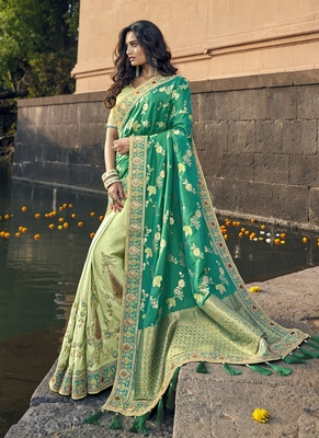 Teal woven silk blend saree with blouse