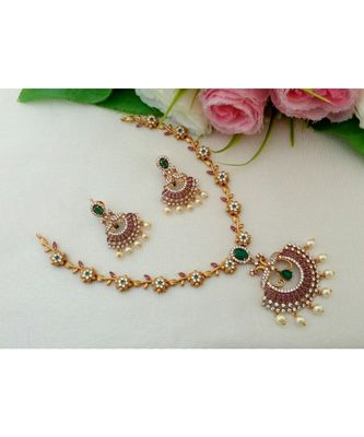 Eye Catching Matt Gold Finish Flower Design Necklace With Peacock Pendant & Matching Ear Rings