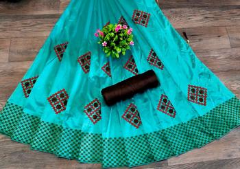 womens turquoise embroidered silk blend saree with blouse