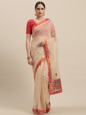 Woman's Chikoo Colored Super Net With Gota Patti Saree