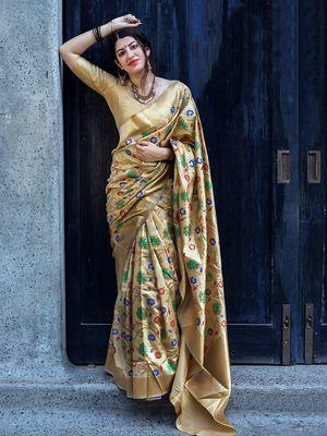 Cream woven banarasi silk saree with blouse