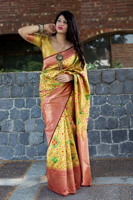 Light yellow woven banarasi silk saree with blouse
