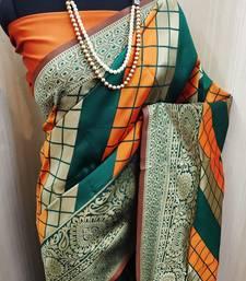 Mustard And Green woven banarasi saree with blouse