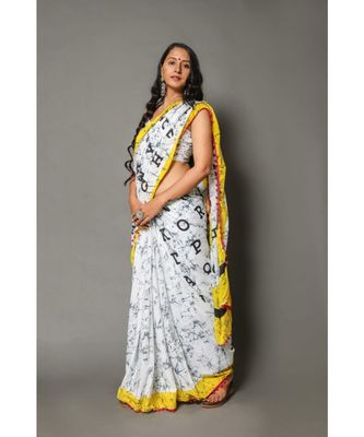 Yellow White Alphabet Print Mul Cotton and Handblock Print Saree paired with Blouse Piece