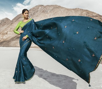 Teal embroidered silk blend saree with blouse