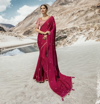 Dark pink embroidered silk blend saree with blouse