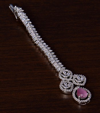 Rhodium Plated Baby Pink and AD Stone Embellished Designer Tikka 217MTS120