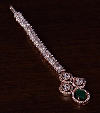 Rose Gold Plated Emerald and AD Stone Embellished Designer Tikka 217MTS122