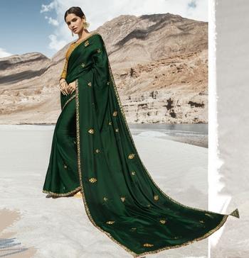 Dark green embroidered silk blend saree with blouse
