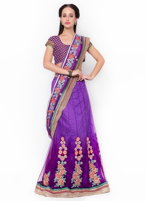 Purple embroidered net saree with blouse