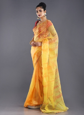 yellow & red organza tie  dye saree with golden border