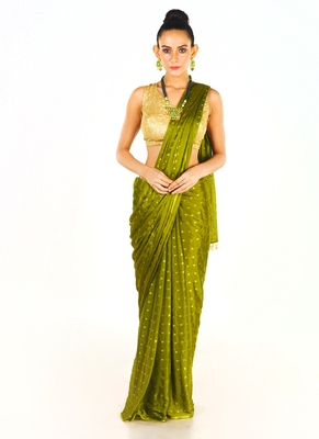 green colour blended chiffon saree with golden fringe lace pallu